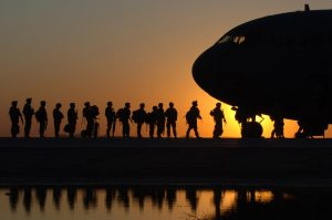 US army boarding military plane